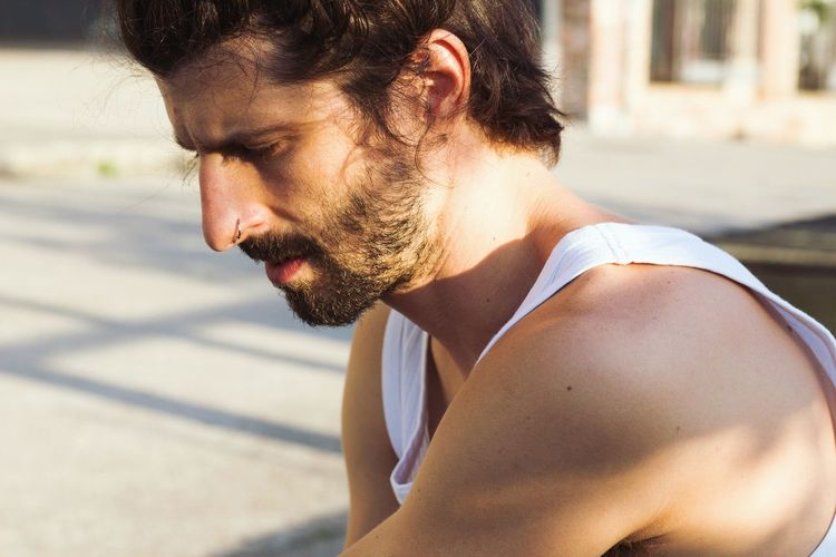 young man with long hair and stylish beard Nose Piercing Tank Top EyeEm Selects Real People Beard One Person Lifestyles Young Adult Outdoors Day Leisure Activity Side View Nature Sunlight Close-up Fresh On Market 2018