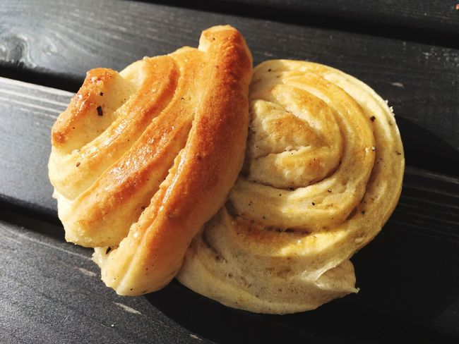 Swedish vanilla bun. Serving Size Fast Food High Angle View No People Unhealthy Eating Sweet Food Indulgence Snack Table Freshness Swedish Fika Fika Pastry Shadows & Lights Carbohydrates Carbohydrate - Food Type Outdoors Sunlight And Shadow