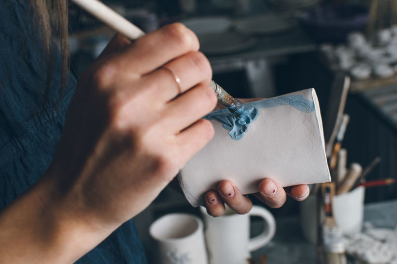 Art And Craft Brush Clay Close-up Creativity Cup Design Professional Female Hands At Work Holding Human Hand One Person Painting Pottery Small Business Unrecognizable Person Woman Woman Hands Workplace