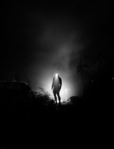 Introspection Architecture Back Lit Copy Space Dark Eerie Full Length Leisure Activity Lifestyles Light At The End Of The Tunnel Men Myself Mysterious Mystery Nature Night One Person Outdoors Real People Rear View Silhouette Sky Standing Unrecognizable Person Walking