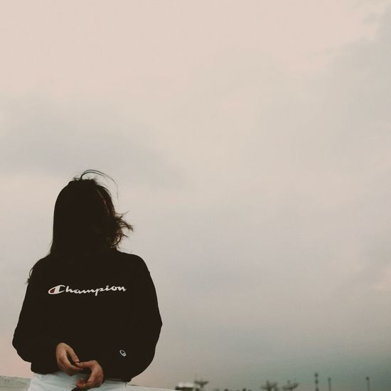 Champion Streetwear Street Fashion Waist Up Only Women Rear View People Adults Only Adult Cloud - Sky Young Women Day One Young Woman Only Politics And Government Outdoors Young Adult Standing Women Silhouette Sky Long Hair