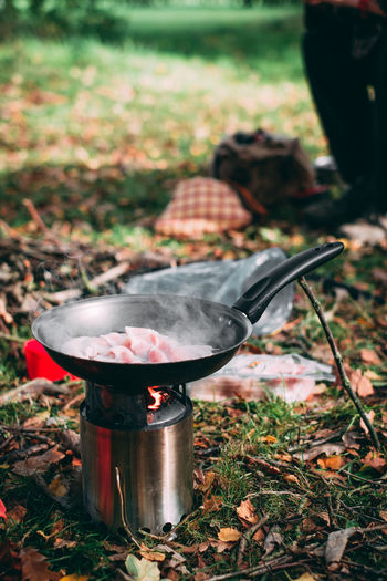 Breakfast Camping Hiking Morning Bacon Burning Camping Stove Container Day Environment Field Fire Fire - Natural Phenomenon Flame Focus On Foreground Food Food And Drink Grass Heat - Temperature Nature No People Outdoors Plant Preparation  Preparing Food
