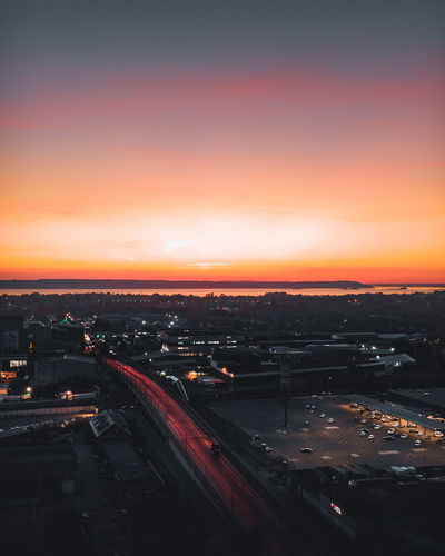 High angle view of traffic on road against sky during sunset