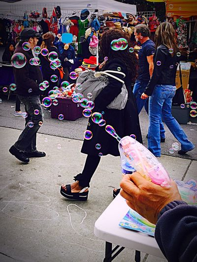 Chance Encounters Large Group Of People Law Crowd People City Outdoors Day Adult Adults Only Bubbles Bubble Gun EyeEm Best Shots Check This Out Colorful Child's Play Carnival Crowds And Details The Street Photographer The Street Photographer - 2017 EyeEm Awards