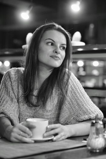 Thoughtful Woman Having Coffee At Table In Restaurant