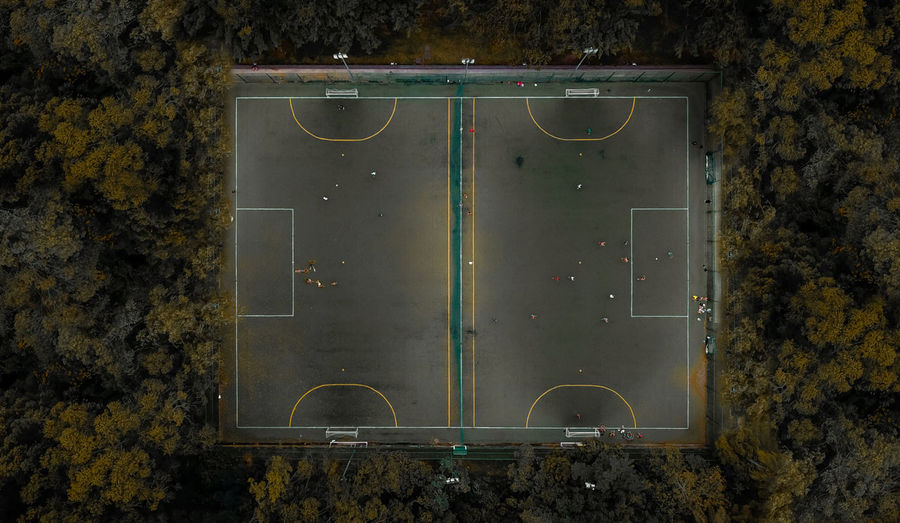 Aerial view of court amidst trees