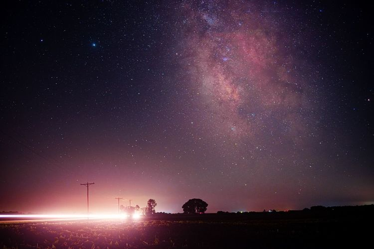 Long exposure shot of milky way while car passes giving slight beem of light