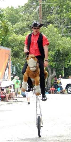 Vertical On The Move Outdoors People Headwear Texas EyeEm Best Shots - Landscape EyeEm EyeEm Gallery Eyeem Market Clown Unicycle Eyeem Collection Entertainment capturing motion Eyeem Photography Adult CyclingUnites Cowboy Stuffed Toy Snap a Stranger Who What Where What Who Where Chance Encounters waiting game Uniqueness