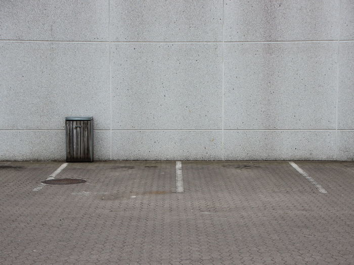 Alone Architecture Building Exterior Built Structure Day Depression Garbage Bin Garbage Can Ghetto Grey Lost No People Outdoors Parking Area Textured