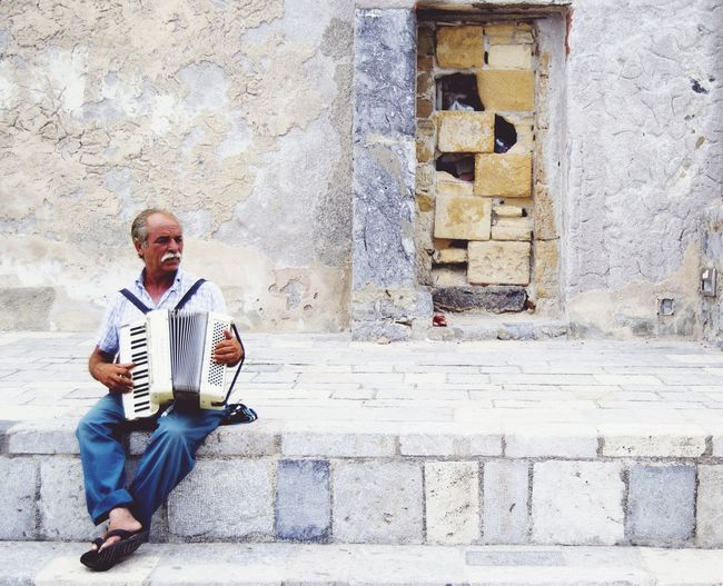 street people Musician Full Length Musical Instrument Sitting Music Portrait Senior Adult City Men Senior Men Office Building Smoking Accordion Building Mustache Cigarette Butt Historic Residential Structure Ashtray  Addiction Cigarette  Building Exterior Street Musician Bad Habit Unhealthy Living Settlement Smoking Issues Exterior Street Art Street Performer