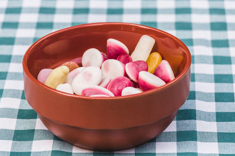 Close-up of a bowl with tasty colorful candies Celebration Dessert Diet Pink Snack Sugar Vacations Bowl Candy Childhood Close-up Food High Angle View Multi Colored No People Pattern Still Life Sweet Sweet Food Table Tablecloth Temptation Unhealthy Eating Unhealthy Food