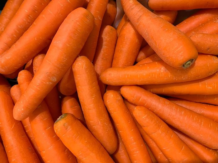 Carrot Root Vegetable Food Food And Drink Vegetable Freshness Healthy Eating Orange Color Wellbeing Full Frame For Sale Large Group Of Objects Backgrounds Abundance No People Still Life High Angle View Retail  Market Raw Food