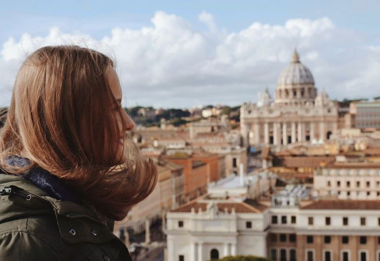Young woman with st peters basilica in background
