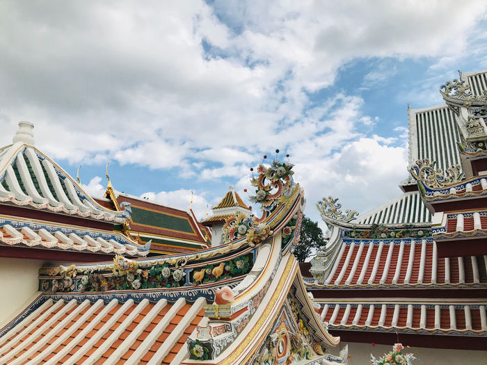 Temple roof chinese style in thailand. low angle view of traditional building against sky.