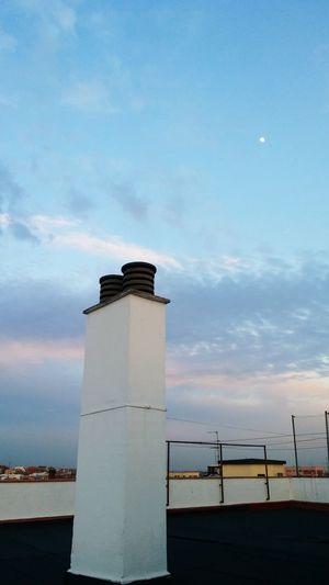 Lighthouse against cloudy sky