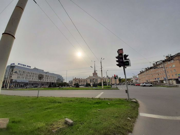 View of street against cloudy sky