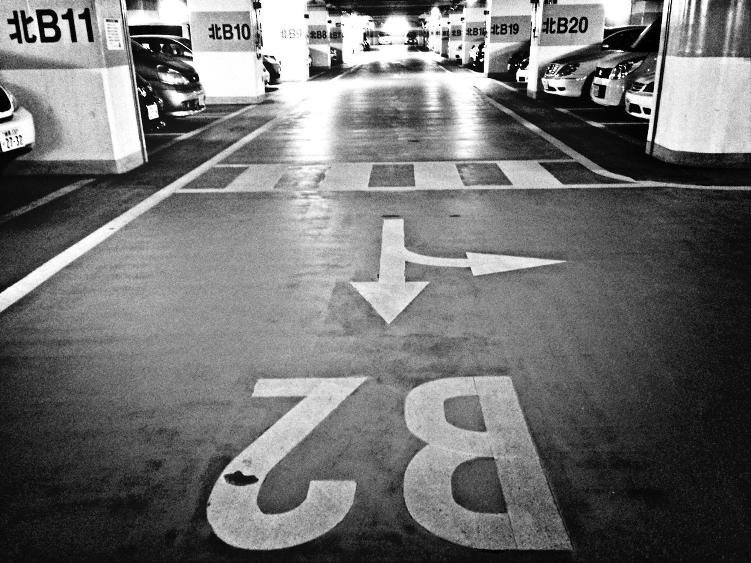 transportation, road marking, road, car, street, land vehicle, mode of transport, text, guidance, communication, asphalt, western script, arrow symbol, road sign, the way forward, sign, city, direction, information sign, directional sign
