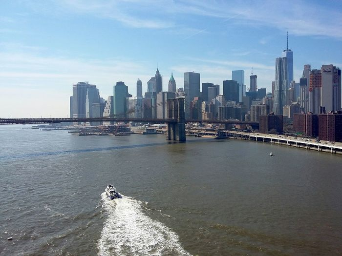Manhattan from the Manhattan Bridge. · New York City New York ❤ NYC USA Skyline Cityscape Architecture Highrises Urban Landscape Waterfront Boat Boat Wake Bridges Great View Tourist Spot