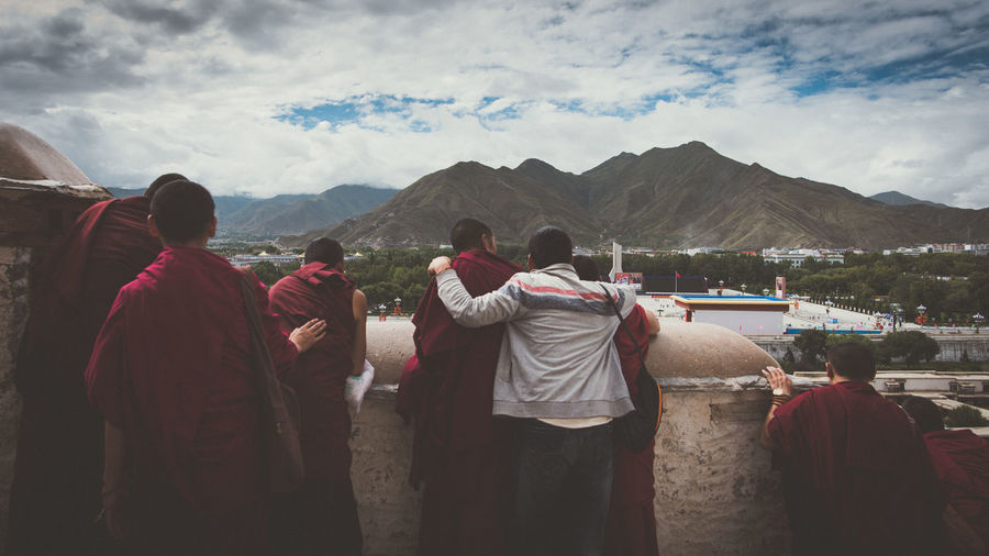 Brotherhood with Monk Monk  Brotherhood Tibetan  Looking At View Outdoors Religion Medium Group Of People Clothing Lifestyles Standing Togetherness Day Group Women Mountain Range Rear View Nature People Men Cloud - Sky Real People Group Of People Mountain EyeEm Selects