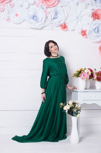 Women Young Adult Young Women One Person Plant Lifestyles Flower Indoors  Beautiful Woman Beauty Fashion Adult Front View Clothing Dress Looking At Camera Full Length Flowering Plant Real People Flower Arrangement Bouquet First Eyeem Photo