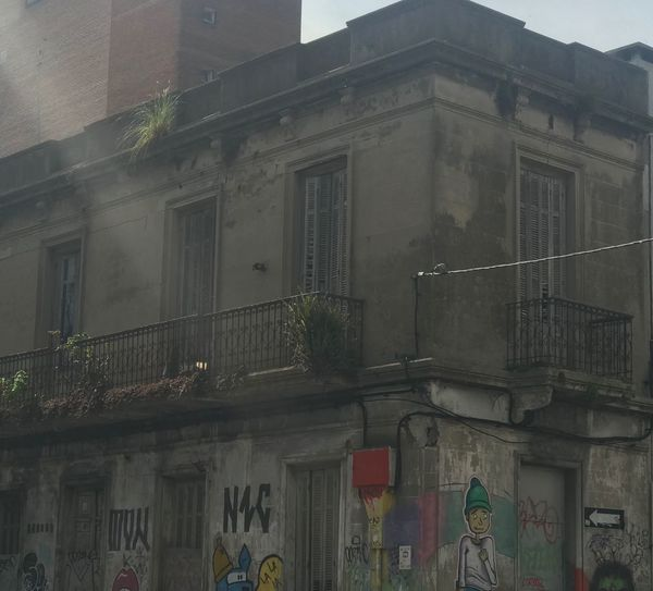 Old house, street art Built Structure Architecture Building Exterior Building Low Angle View Window No People Residential District Day City Outdoors Balcony Old Wall Wall - Building Feature History Entrance Graffiti Nature Door