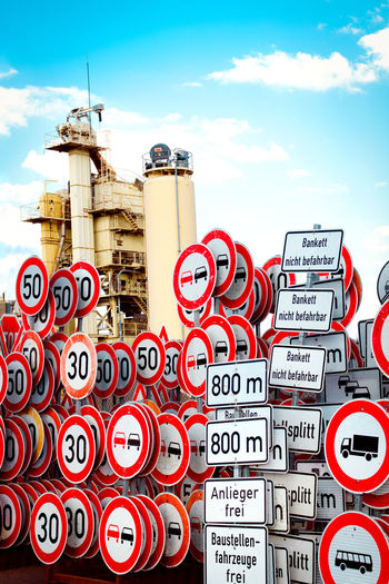 German Traffic Signs Architecture Building Exterior Built Structure Choice City Cloud - Sky Communication Day Different Signs In A Row Large Group Of Objects Low Angle View Nature No People Outdoors Red Sign Sky Speed Limit Sign Text Variation Western Script