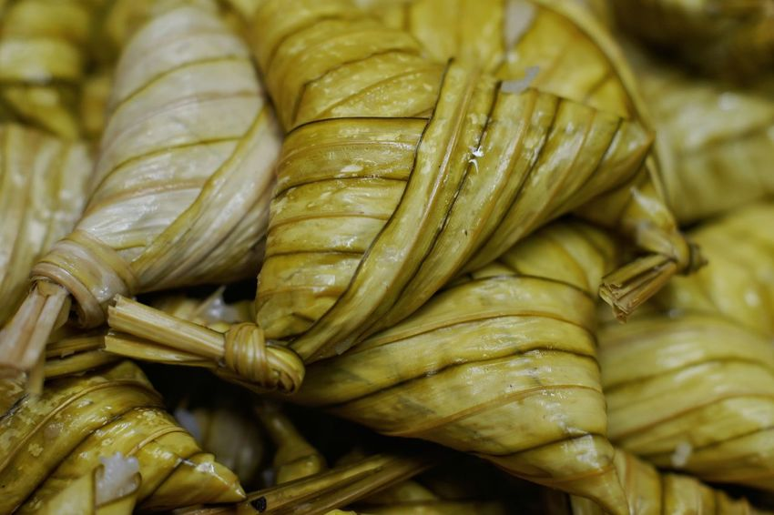 Malaysian traditional food called ketupat palas. It is sticky rice wrapped in palas leaf Food Close-up Healthy Eating No People Indoors  Freshness Horizontal Hari Raya Eid Mubarak Festival Foods Traditional Food Celebration Delicious High Angle View Food And Drink