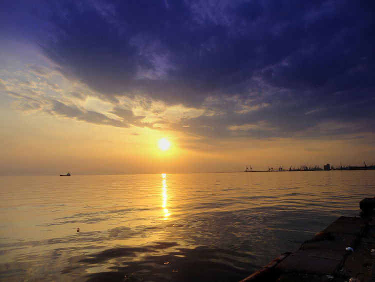 Beauty In Nature Blue Sky And Clouds Calm Calm Sea Cloud Cloud - Sky Dramatic Sky Greek Sunset Horizon Over Water No People Port Cranes Reflection Romantic Landscape Romantic Sunset Scenics Sea Seaside Sunset Seaside Town Sky Sunbeam Sunset Thessaloniki Thessaloniki Port  Thessaloniki Sunset Water