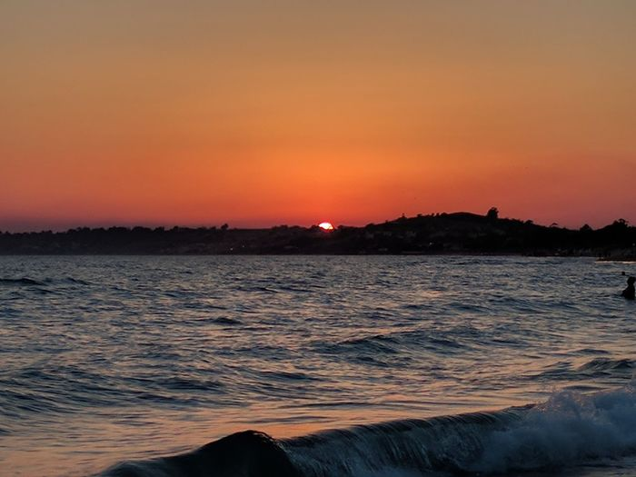 Sunset Sky Water Beauty In Nature Scenics - Nature Sea Orange Color Tranquility Tranquil Scene No People Idyllic Motion Wave Nature Waterfront Land Mountain Beach Non-urban Scene Outdoors Romantic Sky