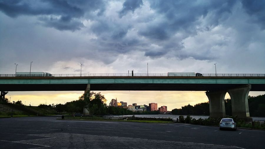 Bridge over road against sky in city