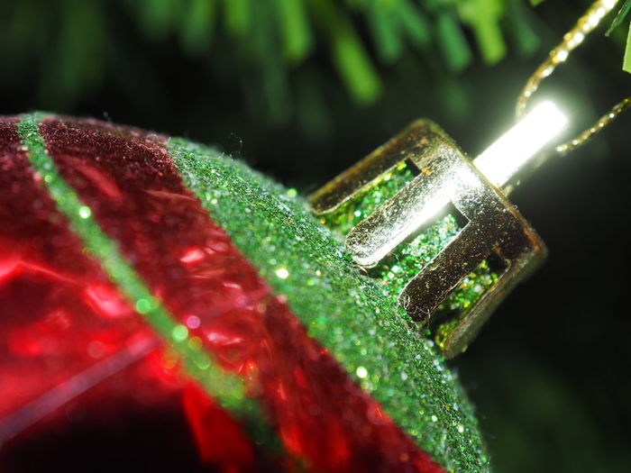 Close-up of bauble hanging on christmas tree