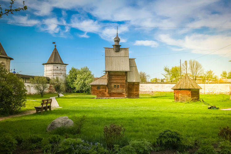Sunny fabulous summer landscape. Lifestyle in the countryside Landscape Photography Sunny Sunnyday☀️ Architecture Cloud - Sky Countryside Day Grass Green Color Landscape Lifestyles Nature No People Outdoors Plant Religion Sky