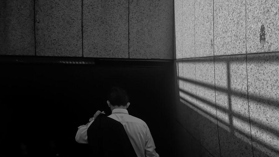 Rear View Of Man Entering Stairways In Building
