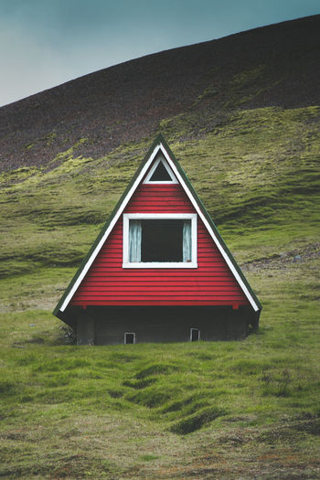 Low angle view of red house on mountain