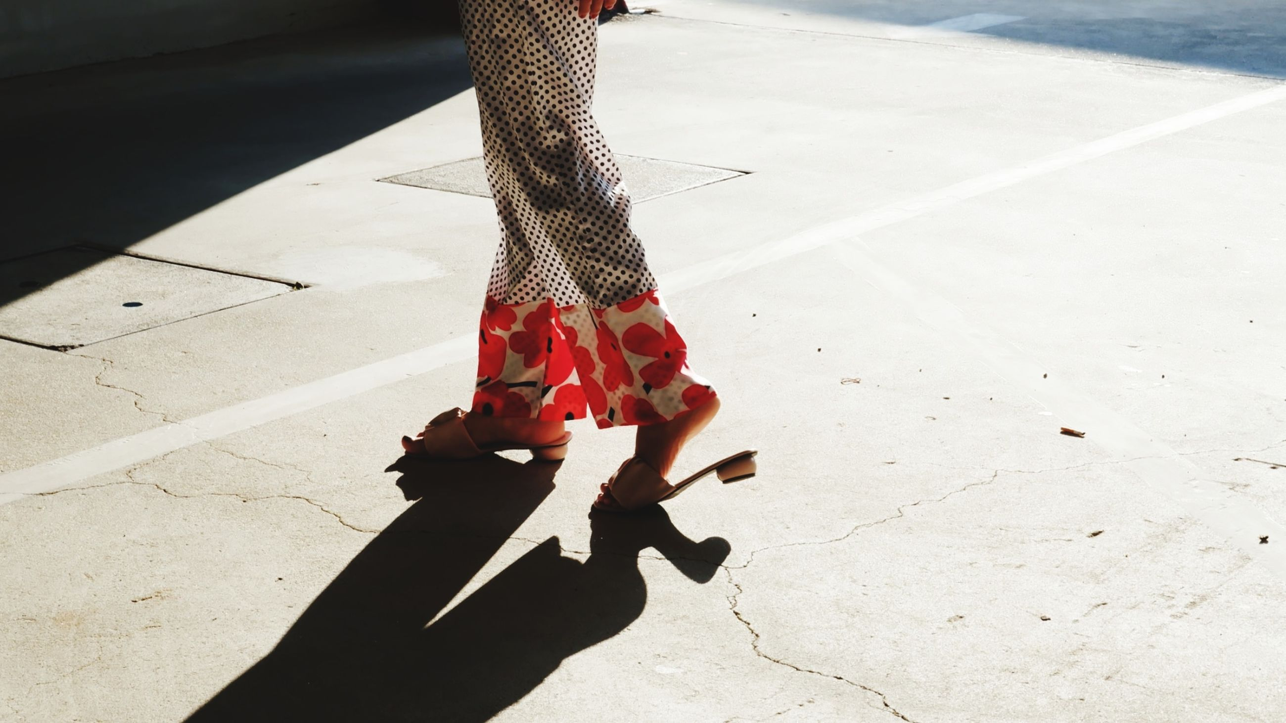 red, shadow, low section, human leg, footwear, one person, sunlight, limb, black, adult, human limb, high heels, day, women, shoe, white, spring, fashion, clothing, lifestyles, nature, city, outdoors, walking, leisure activity, person, street