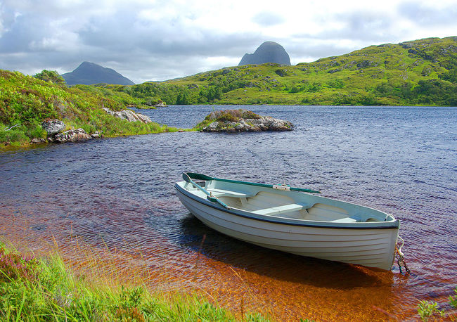 View of Canisp and Suilven Assynt Assynt Hills Beauty In Nature Canisp Cloud - Sky Day Fishing Lake Landscape Loch  Lochinver Mountain Nature Nautical Vessel No People Outdoors Rowing Boat Scenics Sky Suilven Tranquility Travel Destinations Tree Trout Fishing Water