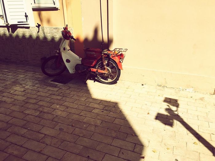 EyeEm Selects Motorcycle Day Sunlight Outdoors Mode Of Transport Shadow Transportation Stationary Architecture No People Building Exterior Scooter Greece Greek Islands Ionian Islands Kefalonia, Greece Holiday Travel Destinations Vacation