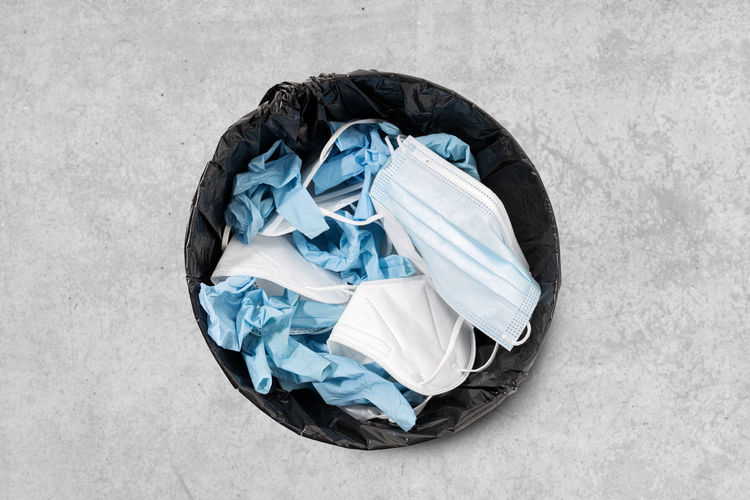 High angle view of garbage can against white background