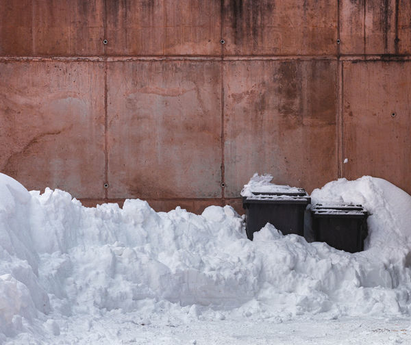 Snow covered wall against building