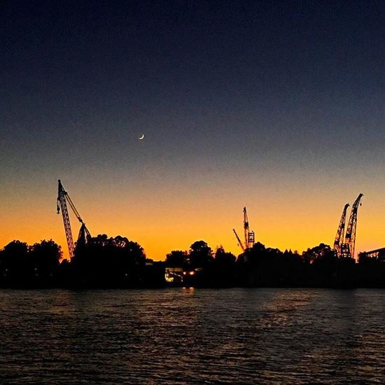 A sliver of moon over Mare Island at sunset as seen from Vallejo