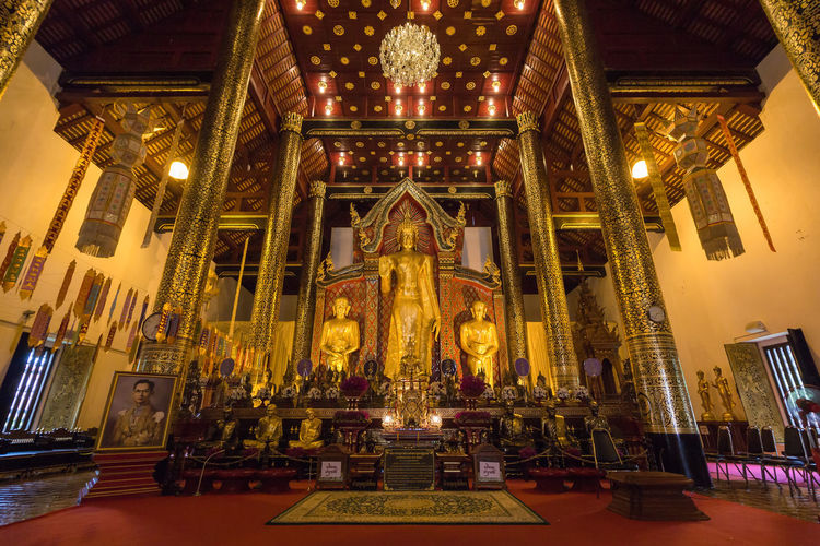 Chiang Mai Chiang Mai | Thailand Altar Architecture Art And Craft Belief Building Built Structure Ceiling Gold Colored Illuminated Indoors  Lighting Equipment Low Angle View No People Ornate Place Of Worship Religion Spirituality Travel Destinations