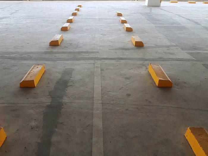 High angle view of yellow container in row