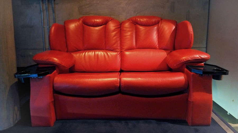 Red color leather movie theater cinema seat chairs which small and old dirty and very bad stingy smell. MOVIE Theater Chairs Cinema Cinema; Theater; Movie; Seats; Empty; Red; Theatre; Chairs; Auditorium; Chair; Row; Seat; Film; Entertainment; Nobody; Interior; Audience; Light; Seating; Comfortable; Show; Dark; Hall; Opera; Projector; Hollywood; Premiere; Numbers; Films; Music; Drama;  Day Indoors  No People Red Seat