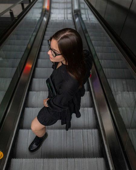 High angle view of woman on escalator