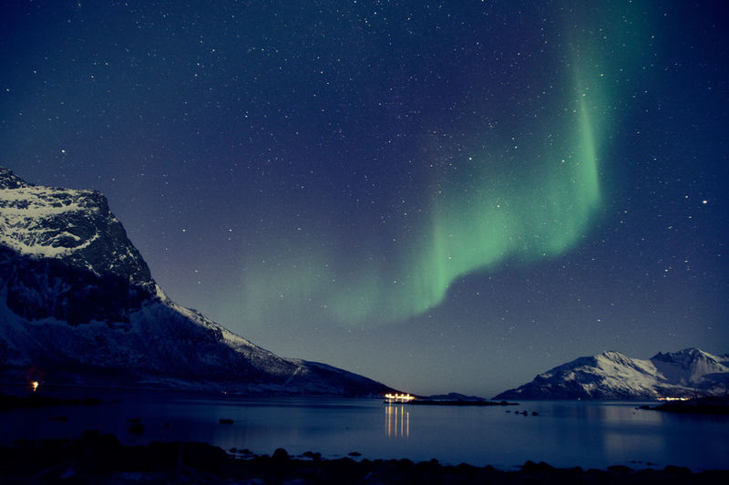 Aurora Borealis spotted in Norway Aurora Borealis Green Sky Northern Lights Norway Tromsø Winter Aurora Polaris Beauty In Nature Blue Sky Mountain Mountain Range Night No People Scenics - Nature Sky Snowcapped Mountain Tranquil Scene Wallpaper