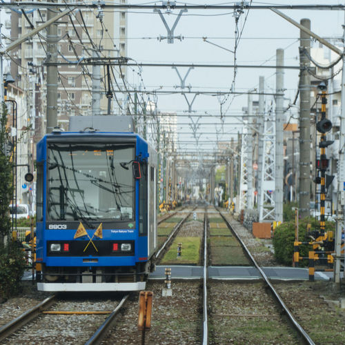 Tram in Tokyo Track Railroad Track Rail Transportation Transportation Public Transportation Mode Of Transportation Electricity  Architecture Day Cable Train Nature Train - Vehicle Railroad Station Platform Railroad Station No People Outdoors Built Structure Technology Connection Power Supply Station