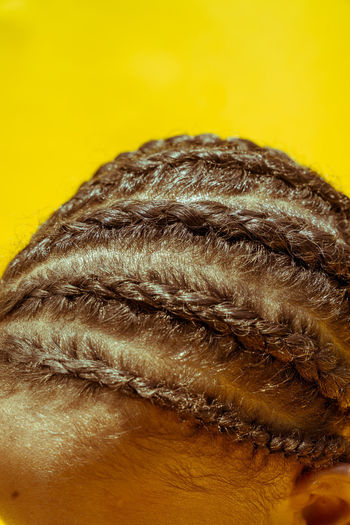 Sunshine and Cornrows Black Girl Magic Black Kids Black Youth Braided Hair Close-up Cornrows Day Freshness Hair Products Hair Styling Headshot Indoors  One Person People Real People Studio Shot Yellow Yellow Background Young Girl With Braids Young Girls