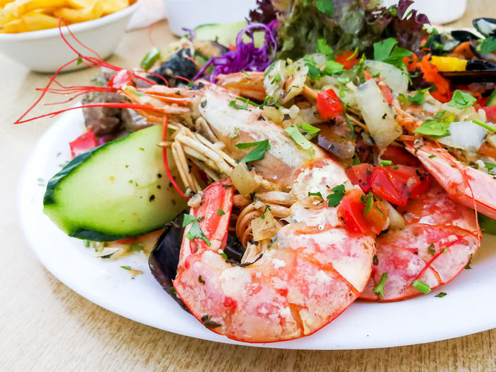 High Angle View Of Prawns With Salad Served In Plate