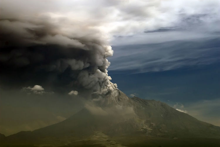 Scenic View Of Volcanic Mountain Against Cloudy Sky