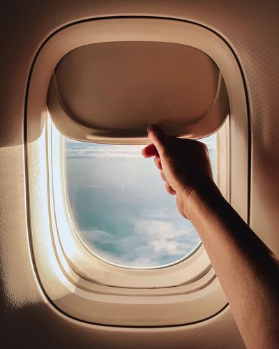 Open or close Airplane Window Window Plane Hand One Person Human Body Part Real People Body Part Window Lifestyles Indoors  The Mobile Photographer - 2019 EyeEm Awards